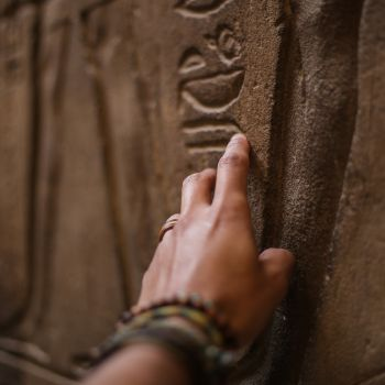 Canva - Close-Up Photo of Person Touching Inscribed Wall