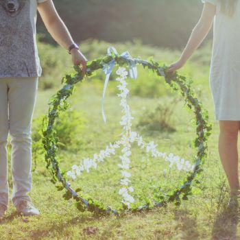 Canva - Two Person Holding White and Green Peace Wreath